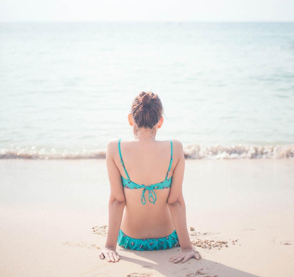 CareAcross-girl-on-beach