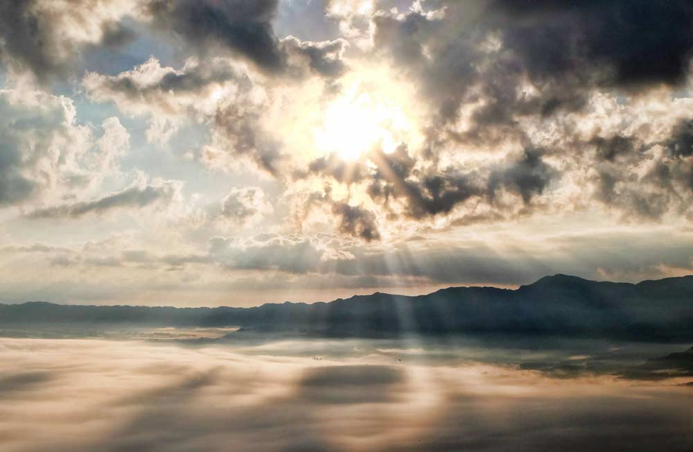 CareAcross-skin-cancer-sun-behind-clouds