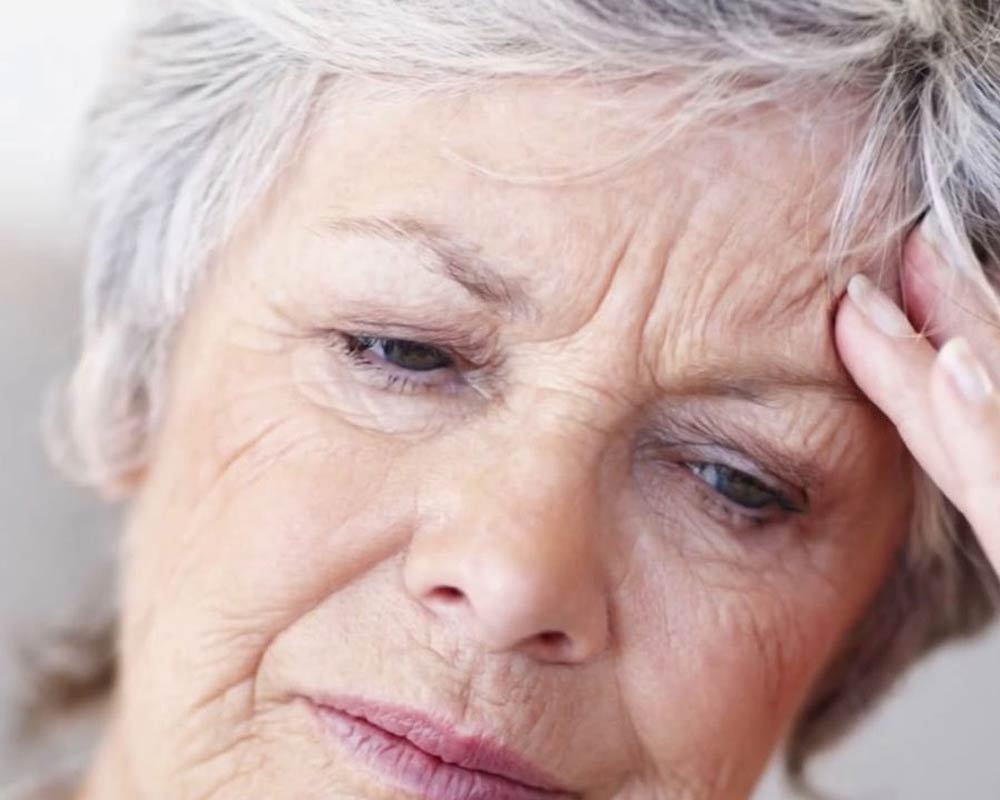 CareAcross-brain-tumors-woman-headache