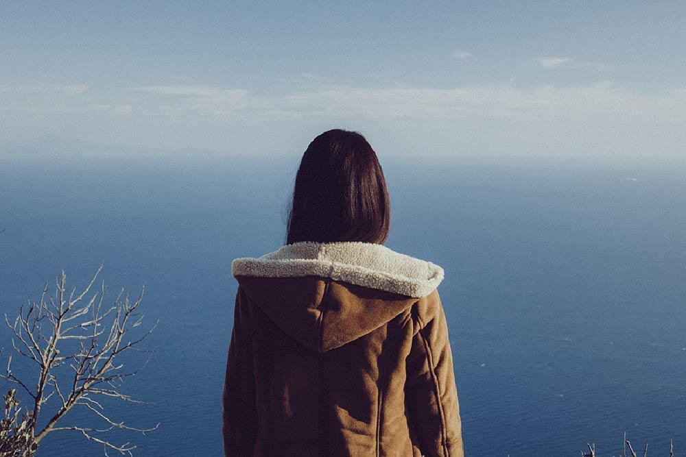 CareAcross-woman-looking-at-sea